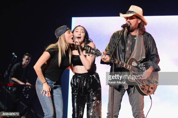 Miley Cyrus Noah Cyrus and Billy Ray Cyrus perform onstage during Katy Perry 'Witness The Tour' at Madison Square Garden on October 6 2017 in New...
