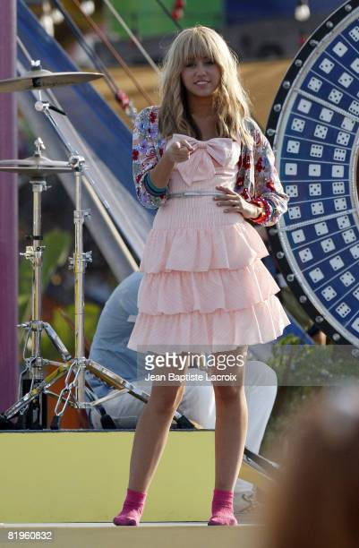 Miley Cyrus on location for 'Hannah MontanaThe Movie' filming on the Santa Monica Pier on July 15 2008 in Santa Monica California