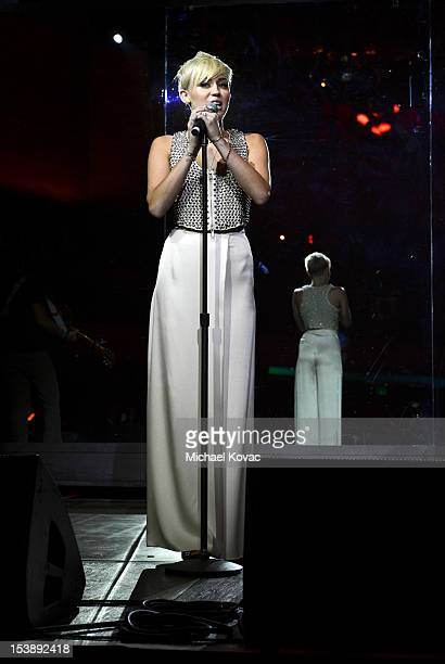Miley Cyrus performs at City Of Hope Honors Halston CEO Ben Malka With Spirit Of Life Award Red Carpet at Exchange LA on October 10 2012 in Los...
