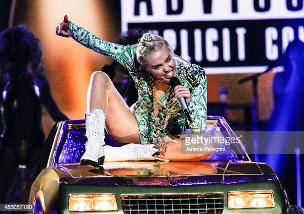 Miley Cyrus performs at Nassau Coliseum on August 1, 2014 in Uniondale, New York.