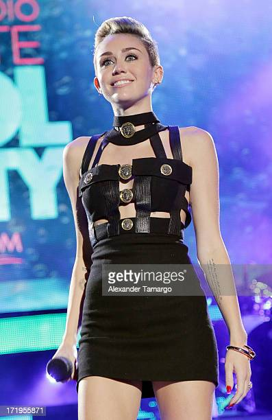 Miley Cyrus performs at the iHeartRadio Ultimate Pool Party Presented By VISIT FLORIDA at Fontainebleau Miami Beach on June 29 2013 in Miami Beach...