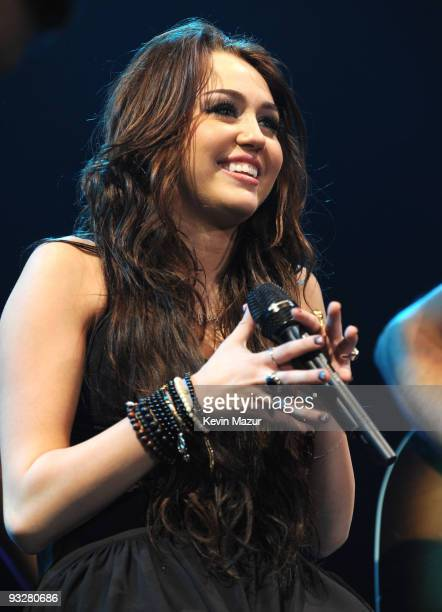 """Miley Cyrus performs during her """"Wonder World"""" tour at Nassau Veterans Memorial Coliseum on November 18, 2009 in Uniondale, New York."""
