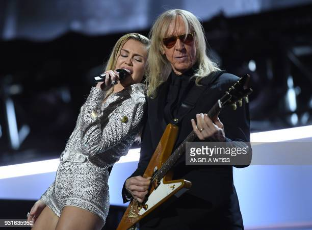 Miley Cyrus performs on stage during the 'Elton John I'm Still Standing A GRAMMY Salute' concert at The Theater at Madison Square Garden in New York...