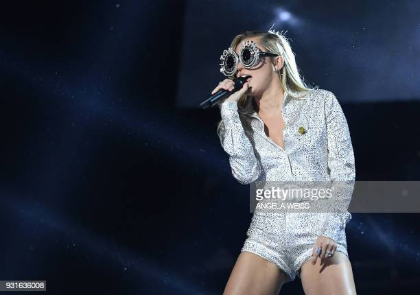 TOPSHOT Miley Cyrus performs on stage during the 'Elton John I'm Still Standing A GRAMMY Salute' concert at The Theater at Madison Square Garden in...