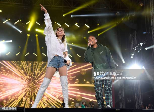 Miley Cyrus performs on stage with Pharrell Williams during the One Love Manchester Benefit Concert at Old Trafford Cricket Ground on June 4 2017 in...