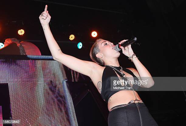 Miley Cyrus performs onstage during Borgore's Christmas Creampies concert held at Henry Fonda Theater on December 8 2012 in Hollywood California