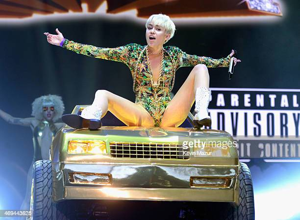 Miley Cyrus performs onstage during her Bangerz tour at Rogers Arena on February 14 2014 in Vancouver Canada