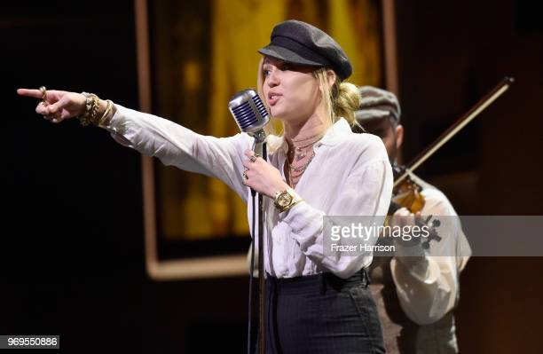 Miley Cyrus performs onstage during the American Film Institute's 46th Life Achievement Award Gala Tribute to George Clooney at Dolby Theatre on June...