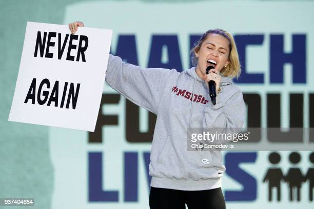 Miley Cyrus performs The Climb during the March for Our Lives rally on March 24 2018 in Washington DC Hundreds of thousands of demonstrators...