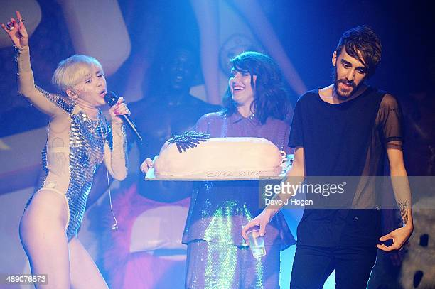 Miley Cyrus performs while a cake is brought out for her friend Cheyne Thomas at GAY on May 9 2014 in London England