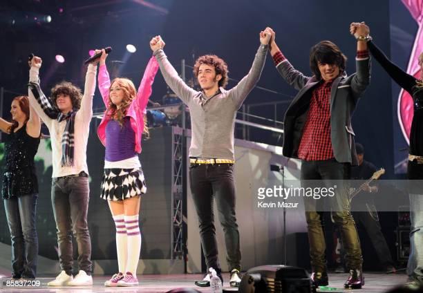 EXCLUSIVE Premium Rates Apply UNIONDALE NY DECEMBER 27 *EXCLUSIVE* Miley Cyrus performs with Nick Jonas Kevin Jonas and Joe Jonas of Jonas Brothers...