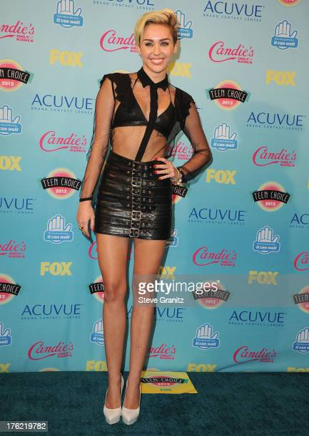 Miley Cyrus poses at the 2013 Teen Choice Awards at Gibson Amphitheatre on August 11 2013 in Universal City California