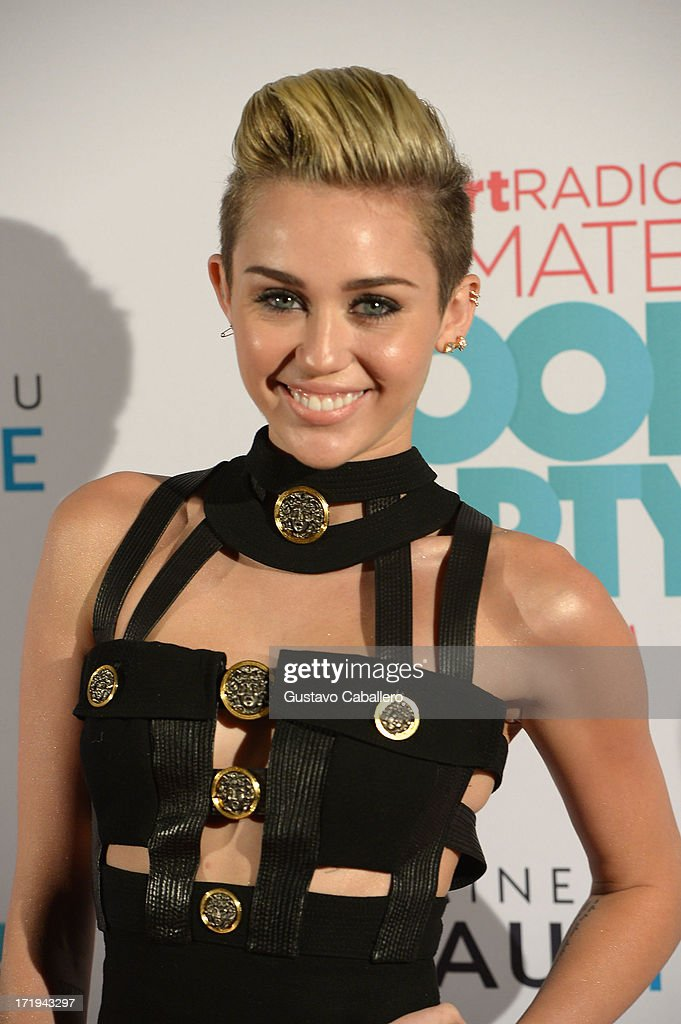 Miley Cyrus poses backstage at the iHeartRadio Ultimate Pool Party Presented by VISIT FLORIDA at Fontainebleau's BleauLive in Miami featuring live performances by Pitbull, Ke$ha, Afrojack, Icona Pop, Krewella and Jason Derulo on June 29, 2013 in Miami Beach, Florida.