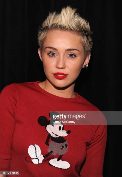 Miley Cyrus poses backstage at the Marc Jacobs Collection Fall 2013 fashion show during MercedesBenz Fashion Week at New York Armory on February 14...