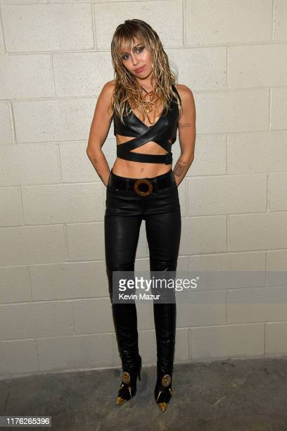 Miley Cyrus poses backstage during the 2019 iHeartRadio Music Festival at TMobile Arena on September 21 2019 in Las Vegas Nevada