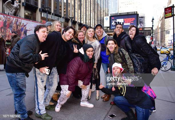 Miley Cyrus poses with fans outside Madison Square Garden on December 10 2018 in New York City