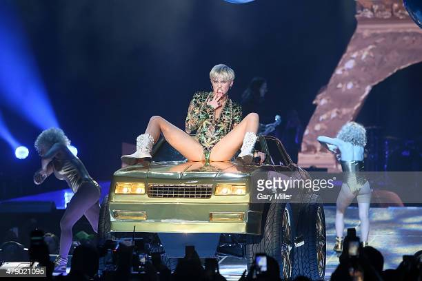 Miley Cyrus shows off the new tattoo inside her mouth as she performs in concert during her Bangerz tour at the ATT Center on March 15 2014 in San...