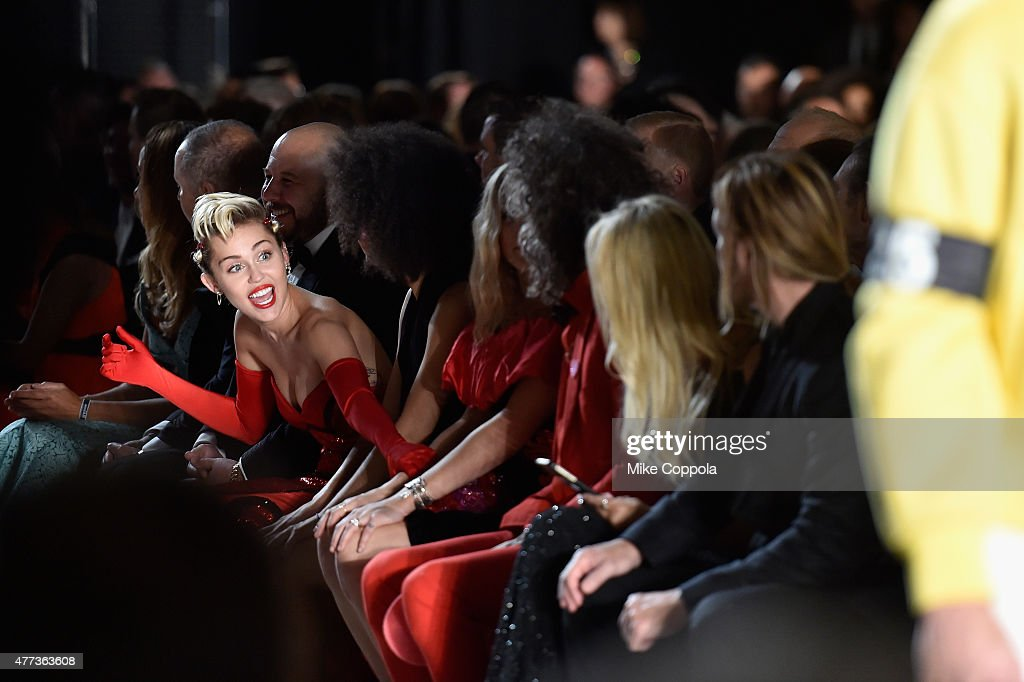 Miley Cyrus sits front row at the 2015 amfAR Inspiration Gala New York at Spring Studios on June 16, 2015 in New York City.