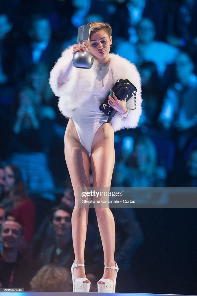 Miley Cyrus smokes a joint onstage during the MTV EMA's 2013 at the Ziggo Dome in Amsterdam, Netherlands.