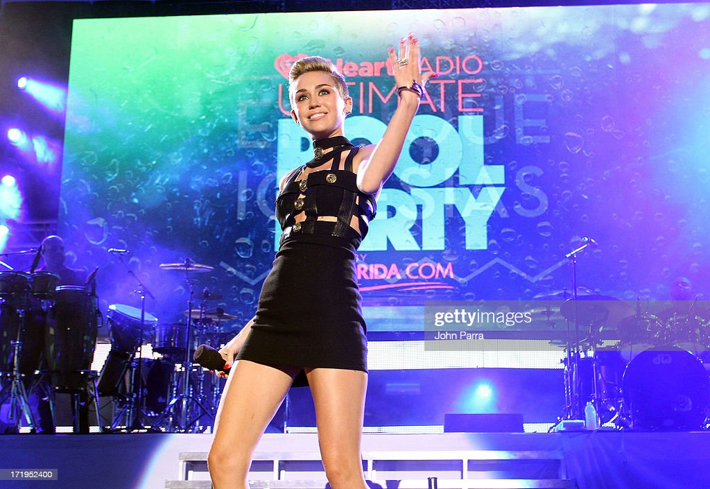 Miley Cyrus speaks onstage at the iHeartRadio Ultimate Pool Party Presented by VISIT FLORIDA at Fontainebleau's BleauLive in Miami on June 29, 2013 in Miami Beach, Florida.