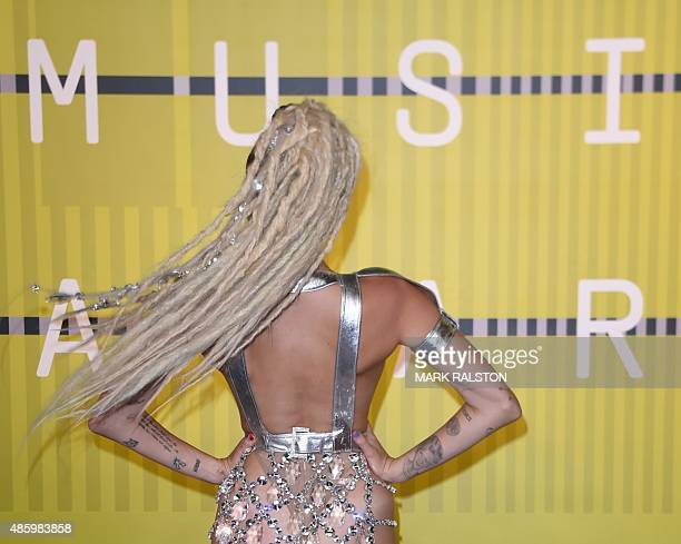 Miley Cyrus styled by Simone Harouche arrives on the red carpet at the MTV Video Music Awards August 30 2015 at the Microsoft Theater in Los Angeles...