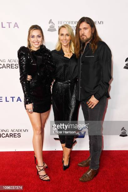 Miley Cyrus Tish Cyrus and Billy Ray Cyrus attend MusiCares Person of the Year honoring Dolly Parton at Los Angeles Convention Center on February 8...