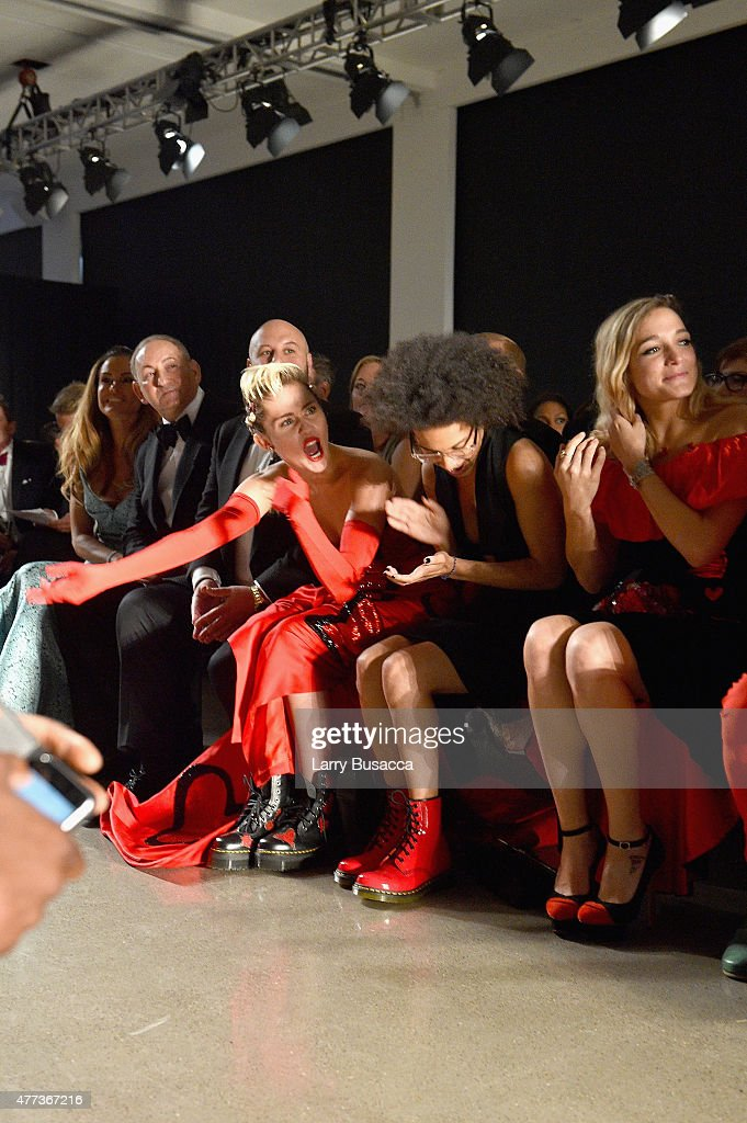 Miley Cyrus, Tyler Ford and Katy Weaver attend the 2015 amfAR Inspiration Gala New York at Spring Studios on June 16, 2015 in New York City.