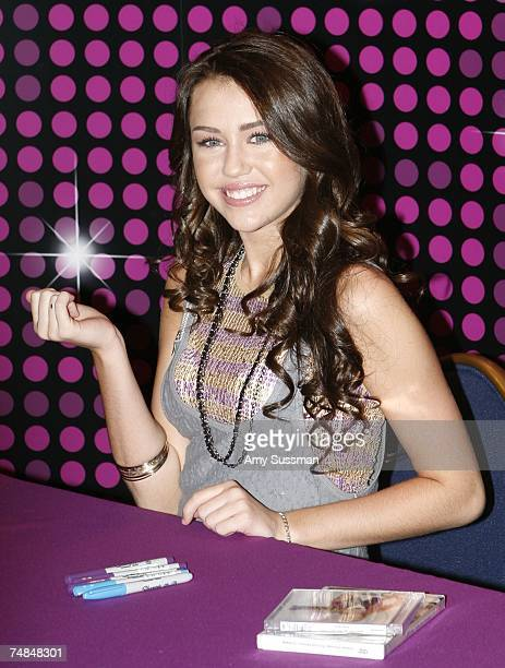 Miley Cyrus who plays the Disney character Hannah Montana signs autographs at the World of Disney store on June 21 2007 in New York City