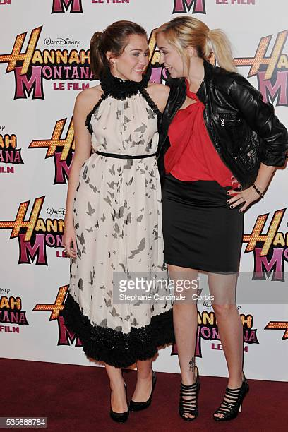 """Miley Cyrus with her sister Brandi attend the premiere of """"Hannah Montana"""" at Gaumont Champs Elysees in Paris."""