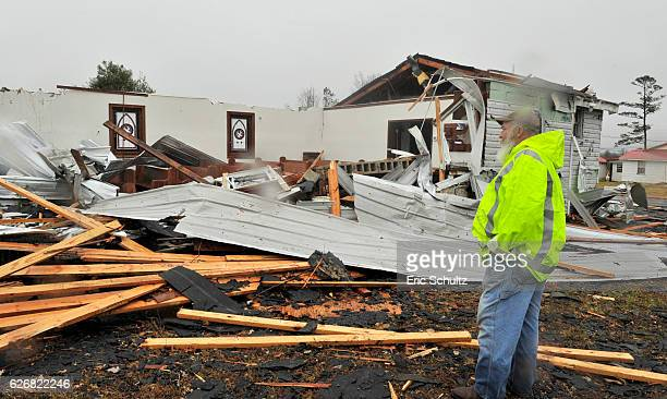 Milford Garrard of Rosalie looks over the damage to the Rosalie Church of God after an earlymorning tornado swept through the center of the small...