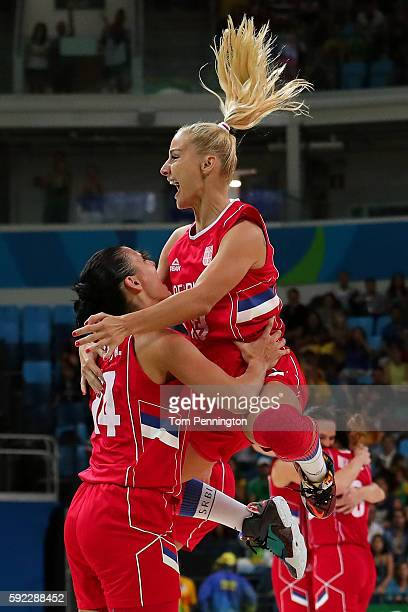 Milica Dabovic of Serbia celebrates with teammate Ana Dabovic after defeating France 7063 in the Women's Bronze Medal basketball game on Day 15 of...