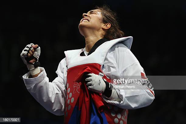 Milica Mandic of Serbia celebrates beating AnneCaroline Graffe of France during the Women's 67kg Taekwondo Gold medal match on on Day 15 of the...