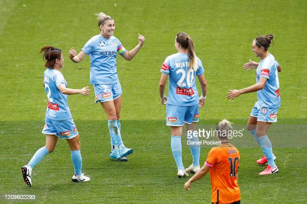 Milica Mijatovic of Melbourne City celebrates with Stephanie Catley of Melbourne City and teammates after kicking a goal during the round 14 WLeague...