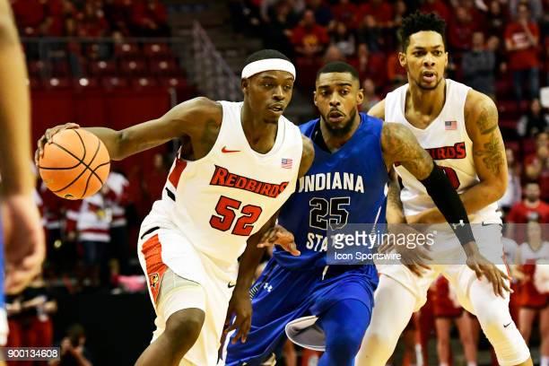 Milik Yarbrough forward Illinois State University Redbirds drives for the goal inside Qiydar Davis guard Indiana State Sycamores Sunday December 31...