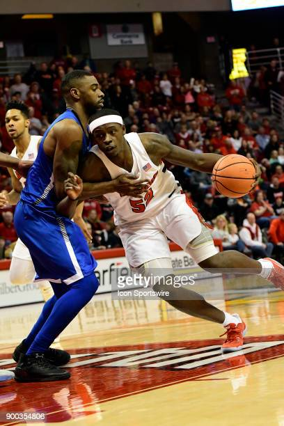 Milik Yarbrough forward Illinois State University Redbirds drives into the paint against Qiydar Davis guard Indiana State Sycamores Sunday December...