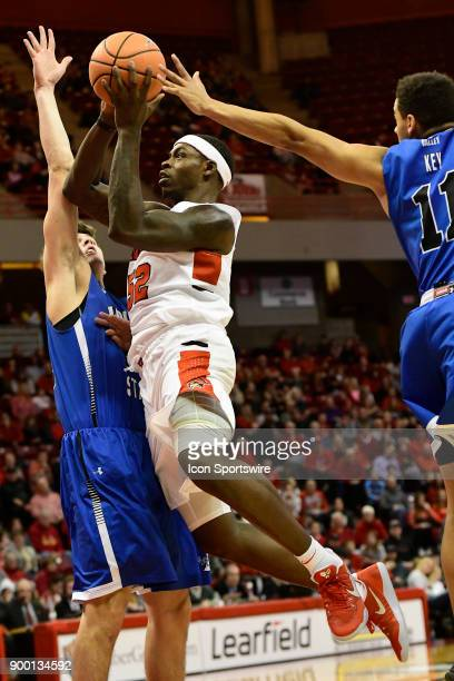 Milik Yarbrough forward Illinois State University Redbirds goes for two of his gamehigh 29 points against Clayton Hughes guard and Tyreke Key guard...