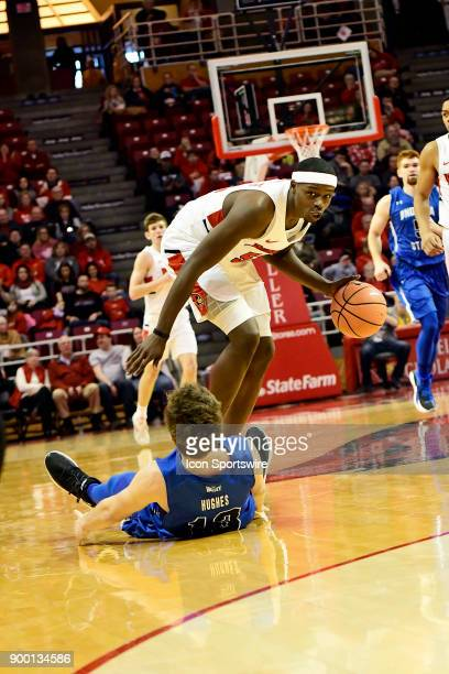 Milik Yarbrough forward Illinois State University Redbirds is called for a charge against Clayton Hughes guard Indiana State Sycamores Sunday...