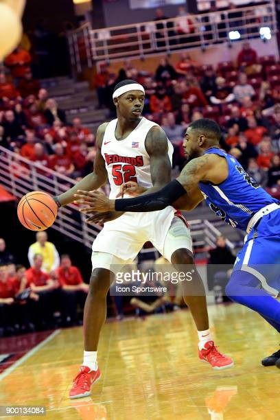 Milik Yarbrough forward Illinois State University Redbirds keeps the basketball away from Qiydar Davis guard Indiana State Sycamores Sunday December...