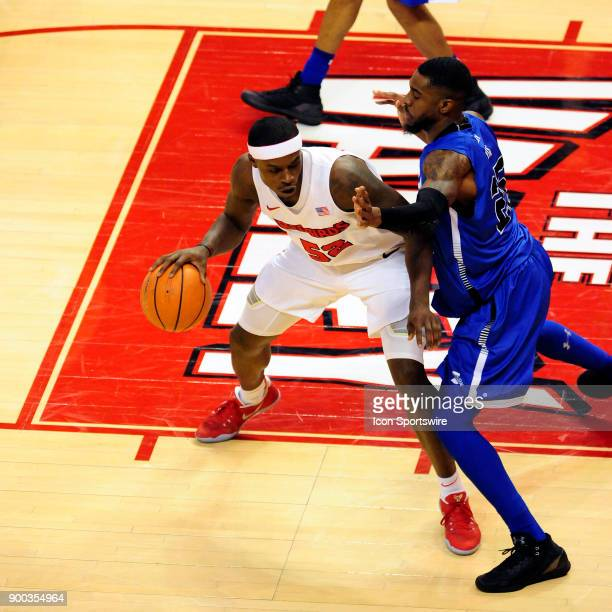 Milik Yarbrough forward Illinois State University Redbirds keeps the basketball away from Qiydar Davis guard Indiana State Sycamores Sunday December...
