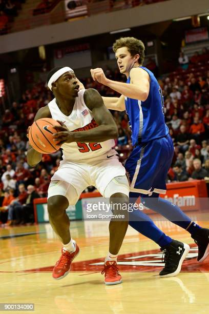 Milik Yarbrough forward Illinois State University Redbirds looks for two of his gamehigh 29 points against Clayton Hughes guard Indiana State...