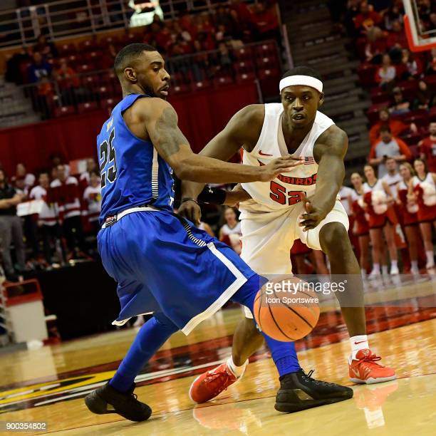 Milik Yarbrough forward Illinois State University Redbirds passes the basketball around Qiydar Davis guard Indiana State Sycamores Sunday December 31...