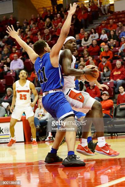 Milik Yarbrough forward Illinois State University Redbirds sets in the paint to shoot for two points against Tyreke Key guard Indiana State Sycamores...