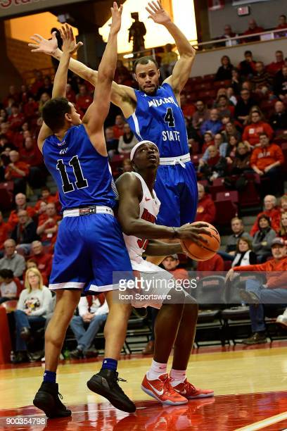 Milik Yarbrough forward Illinois State University Redbirds sets in the paint to shoot for two points against Tyreke Key guard and Brenton Scott guard...