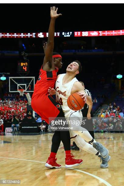 Milik Yarbrough of the Illinois State Redbirds defends against Ben Richardson of the Loyola Ramblers during the Missouri Valley Conference Basketball...
