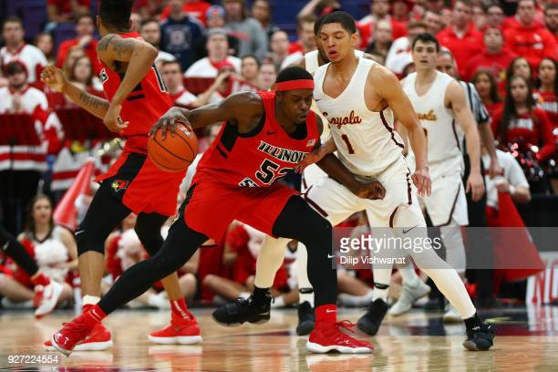Milik Yarbrough of the Illinois State Redbirds looks to get pst Lucas Williamson of the Loyola Ramblers during the Missouri Valley Conference...