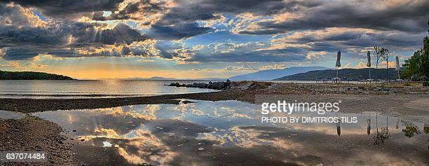 milina's beach at sunset panorama - volos stock pictures, royalty-free photos & images