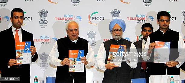 Milind Deora Union Minister for Communications IT Kapil Sibal Prime Minister Manmohan Singh Minister of State for Communications and Information...