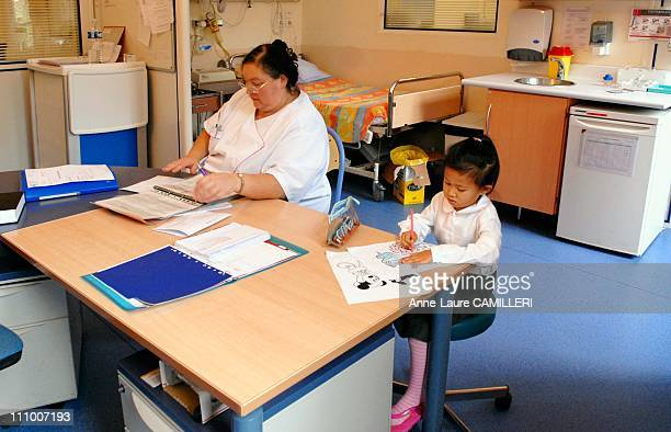 Milinda a fourandahalf year old Laotian girl stays at Chateau des Cotes in the elder children unit She is drawing in the medical office next to a...