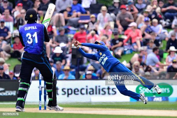 Milinda Siriwardana of Sri Lanka attempts to catch batsman Martin Guptill of New Zealand during the second one day international cricket match...