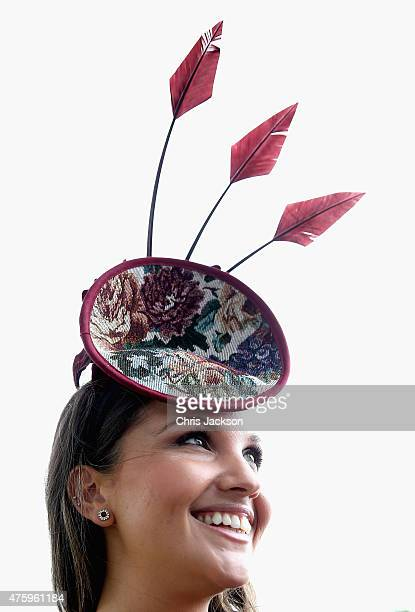 Miliner Rachel Hanson poses for a photograph as she arrives at Ladies Day at the Investec Derby Festival on June 5 2015 in Epsom England
